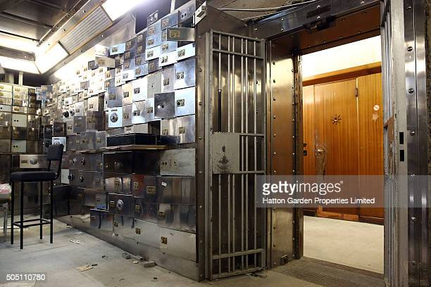 Smashed safe deposit boxes and the fortified entrance are pictured in the underground vault of the Hatton Garden Safe Deposit Company which was...
