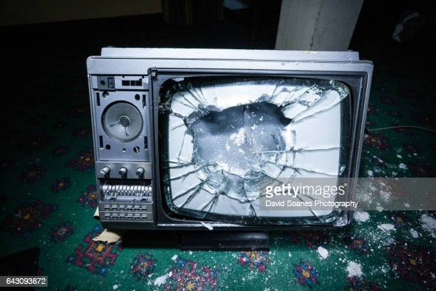 a smashed television on the ground - demolishing stock pictures, royalty-free photos & images