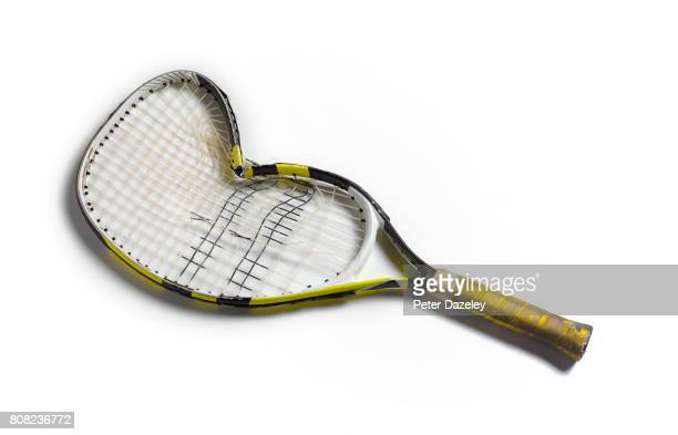 smashed tennis racket - tennis racquet stock pictures, royalty-free photos & images