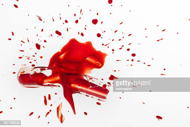 Smashed test tube spilling blood