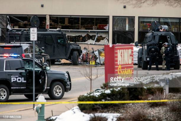Smashed windows are left at the scene after a gunman opened fire at a King Sooper's grocery store on March 22, 2021 in Boulder, Colorado. Ten people,...