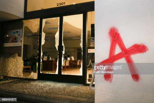 Smashed windows at a bank are seen following a protest on February 1 2017 in Berkeley California A speech by controversial Breitbart writer Milo...