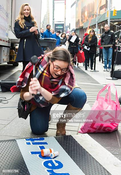 Smashing pill bottles A Shredit mobile shredding truck shreds participants bad memories Ninth Annual Good Riddance Day Broadway Plaza between 43rd...