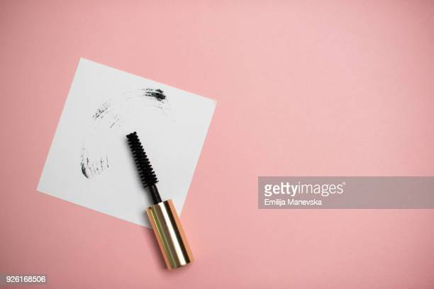 a smear of black mascara brush - eye make up stock photos and pictures