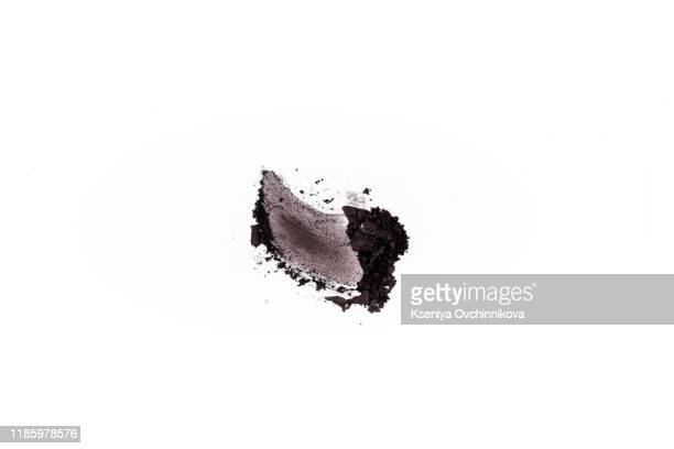 smear of crushed brown eyeshadow as sample of cosmetic product isolated on white background - stroking stock pictures, royalty-free photos & images