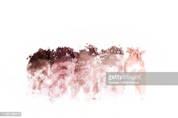 smear of crushed multicolored eye shadow as sample of cosmetic product isolated on white background - hitting stock pictures, royalty-free photos & images