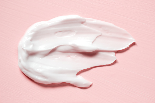 Smear of natural moisturizer in pink background. Cream, Lotion for face or body. Skin care. 997647104