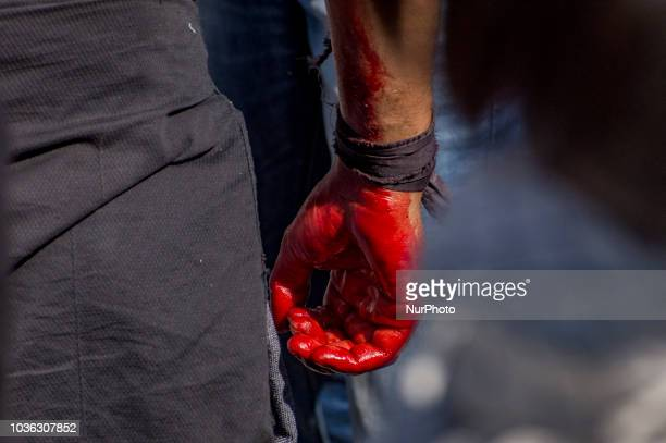 Smeared in blood a Kashmiri Shiite Muslim mourners flagellates himself during a Muharram procession on September 19 2018 in Srinagar the summer...