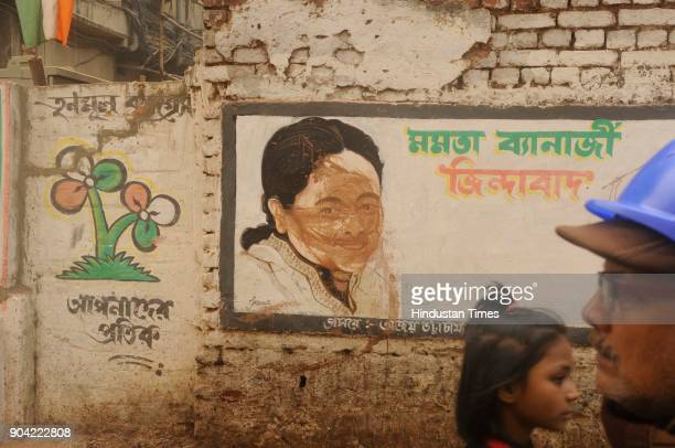 Smeared mud on cartoon of West Bengal Chief Minister Mamata Banerjee in front of Binani Bhawan due to clash between Bharatiya Janata Party and...