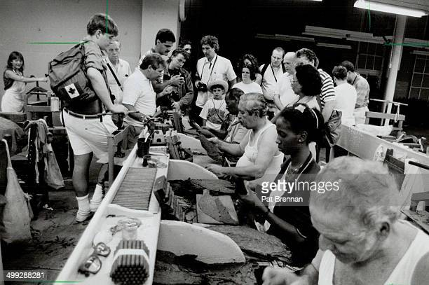Smell of success Tom Hinds left and Michael Nouri inspect tobacco crop in Cuba Havana factory turns out cigars for export