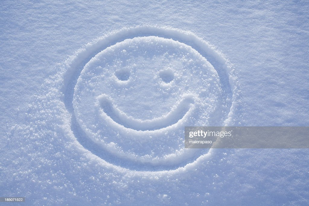 Smile. A face drawing in the snow. : Stock Photo