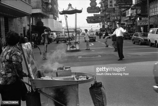 A smile and a wave from Australian policeman Geoff Little of the International Police Association as he directs traffic at the junction of Percival...