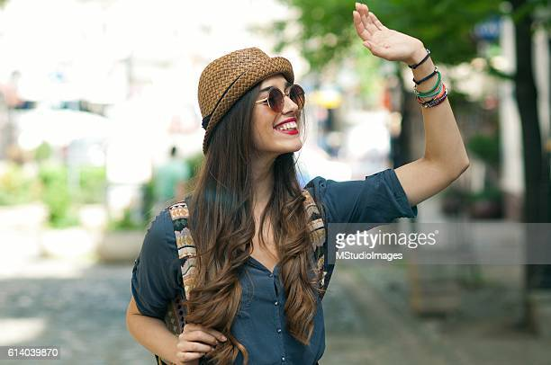 smile and wave. - waving gesture stock pictures, royalty-free photos & images