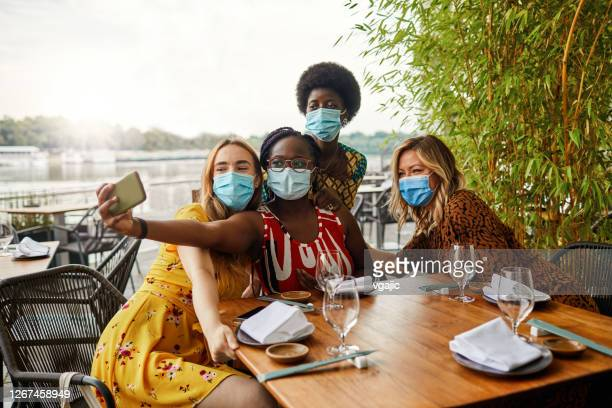 smile behind the face masks - new normal friendship concept - amizade feminina imagens e fotografias de stock