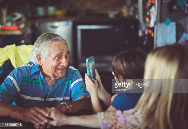 smile for the camera, great grandfather, and granddaughter - 90 plus years stock pictures, royalty-free photos & images