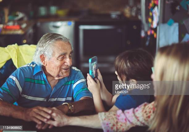 smile for the camera, great grandfather, and granddaughter - great granddaughter stock photos and pictures