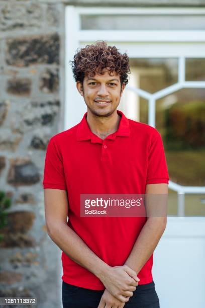 smile for the camera - polo shirt stock pictures, royalty-free photos & images