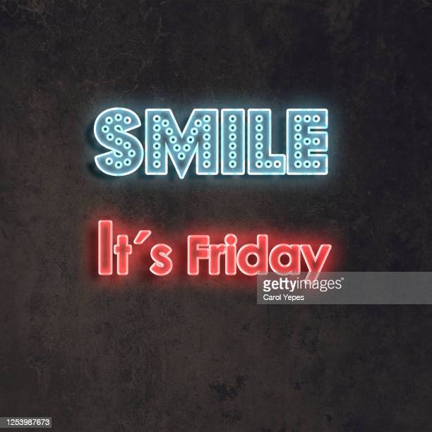 smile it´s friday text in neon lights and black background - friday stock pictures, royalty-free photos & images