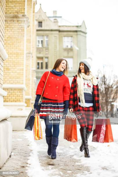 Smile of happy girls after shopping