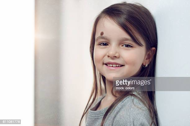 smile of little girl - mole stock photos and pictures