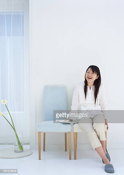 Smiled woman sitting on chair
