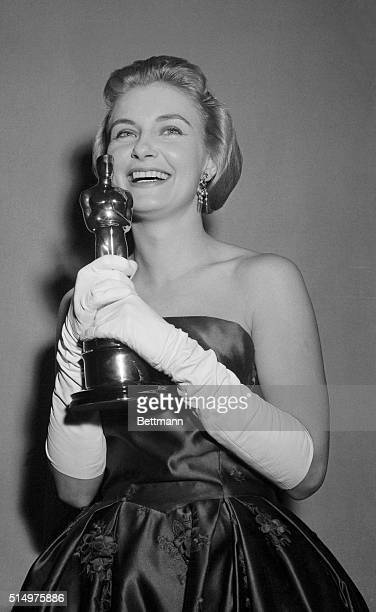 """Smiles come easy to actress Joanne Woodward who poses here March 26th with her """"Oscar"""" after she won the Academy Award as the best actress for her..."""