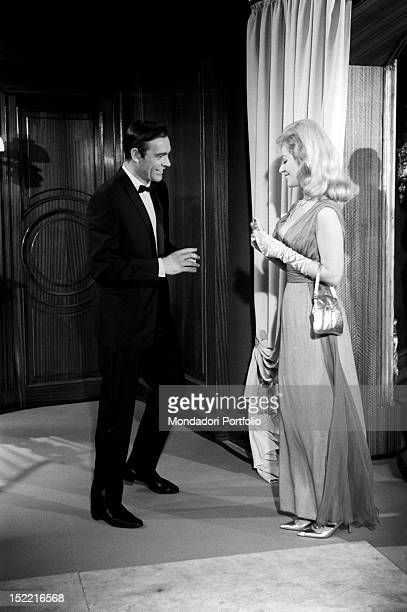 A smiley actor Sean Connery addresses an elegant walkon actress on the set of Thunderball fourth episode of secret agent 007's series Pinewood march...