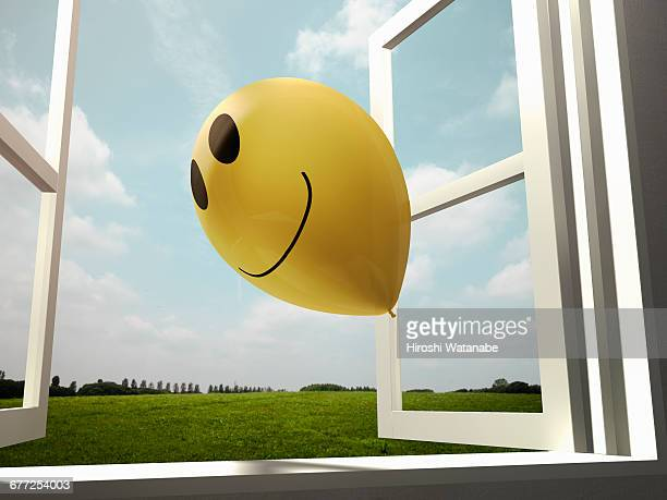 Smiley balloon  flies away to the sky