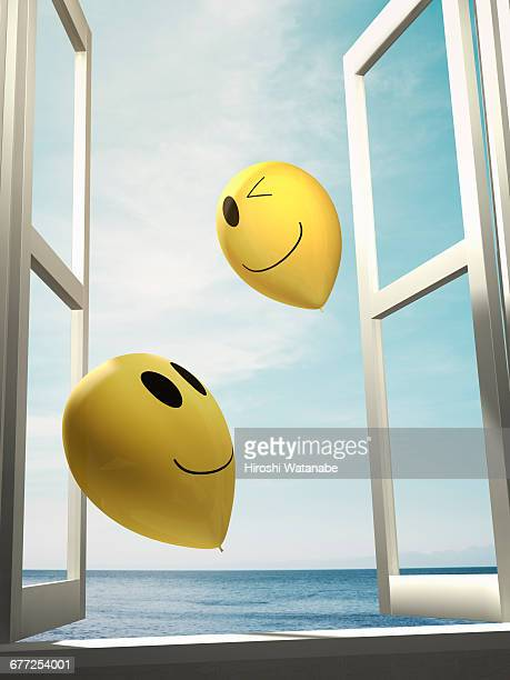 Smiley balloons  fly away to the sky