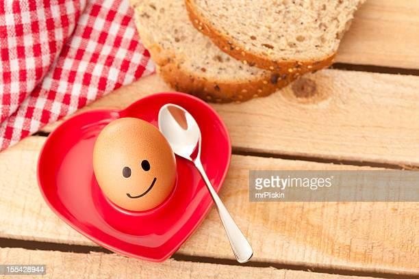 Smiley boiled egg in eggcup