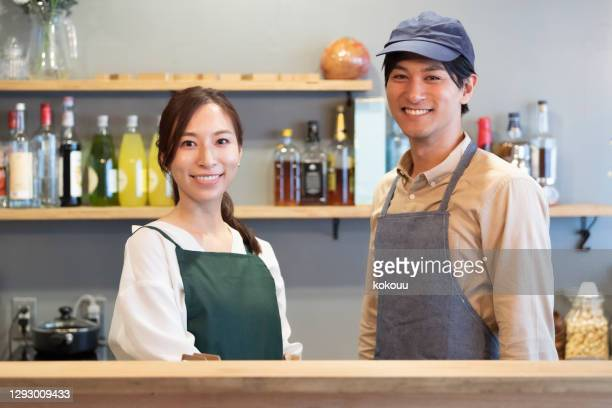 smiley cafe staff, portrait - catering building stock pictures, royalty-free photos & images