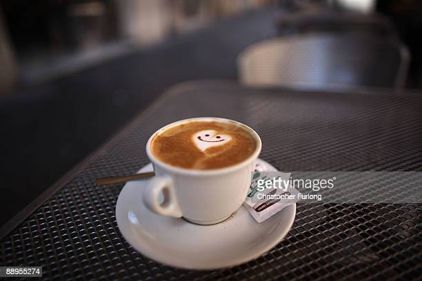 A smiley face and heart adorns the froth of a cappucino reflecting the romance of Rome on July 9 2009 in Rome Italy With nearly 3000 years of history...