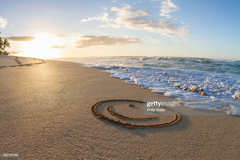 Smiley face, drawn in sand, sunset, Hawaii : Stock Photo