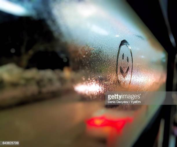 Smiley Face Drawn On Condensed Glass At Night