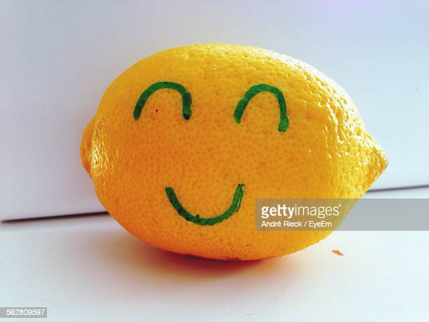 Smiley Face Drawn On Lemon