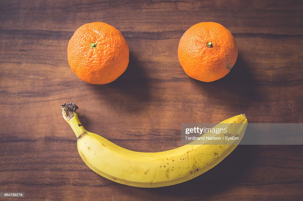 Banana On Table Smiley Face Made Of Oranges And Banana On Table : Stock Photo