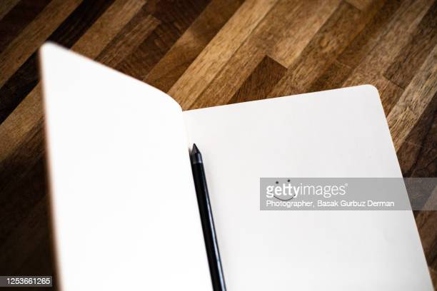 a smiley face on a notebook - memorial stock pictures, royalty-free photos & images