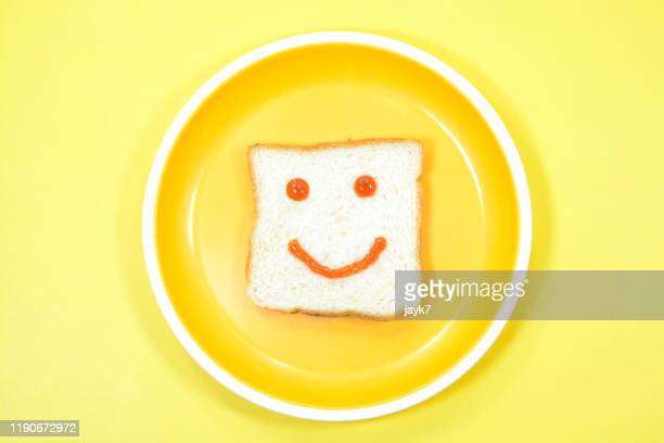 smiley face - breakfast cartoon stock pictures, royalty-free photos & images