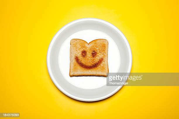 smiley face toast o a plate - smiley face stock pictures, royalty-free photos & images