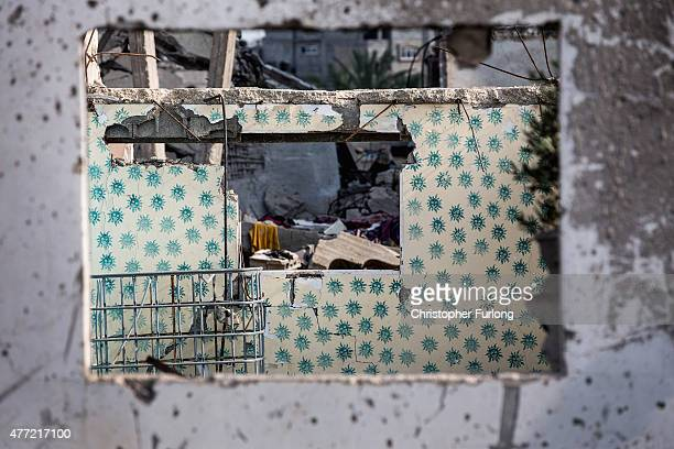 Smiley face wallpaper adorns the walls of a child's bedroom now destroyed by Israeli bombs on June 15 Gaza City Gaza The devastation across Gaza can...