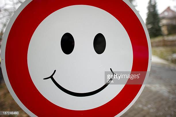 A smiley is fixed to a 'no entry' sign in Dresden eastern Germany on January 16 2012 AFP PHOTO / ARNO BURGI GERMANY OUT