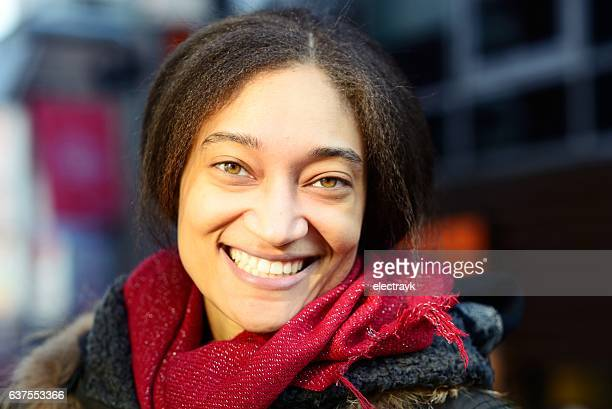 smiley young woman looking at camera - minority groups stock pictures, royalty-free photos & images