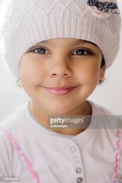 smiling 4 years old girl wearing pink hat, indoors - children only stock pictures, royalty-free photos & images