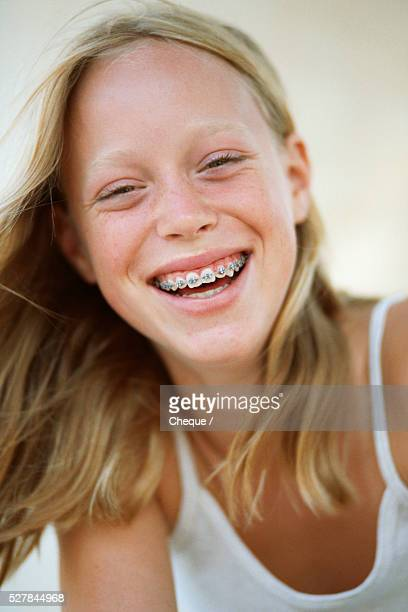 smiling adolescent girl with braces - only teenage girls stock pictures, royalty-free photos & images