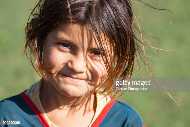 A smiling afghan migrant girl