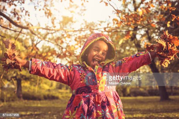 smiling african america girl in nature. - young leafs stock photos and pictures