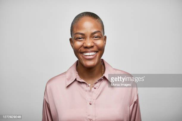 smiling african american female entrepreneur on white background - headshot stock pictures, royalty-free photos & images