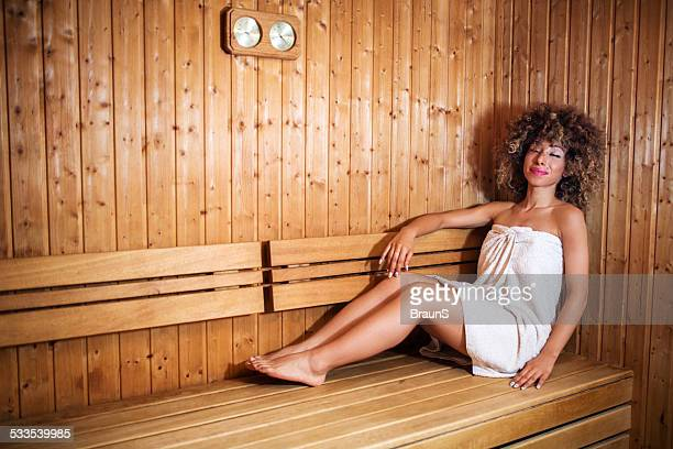 smiling african american woman enjoying in sauna. - black woman in sauna stock pictures, royalty-free photos & images