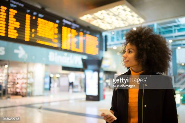 smiling african american woman. - railway station stock pictures, royalty-free photos & images