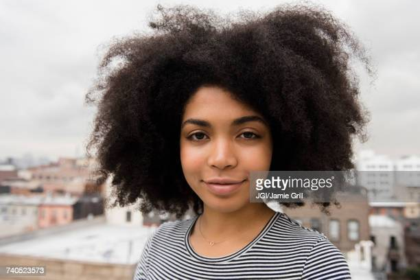 Smiling African American woman posing on rooftop